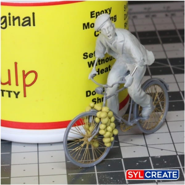 A scale model of a French man on a bicycle sculpted using Magic Sculp Epoxy Modelling Putty