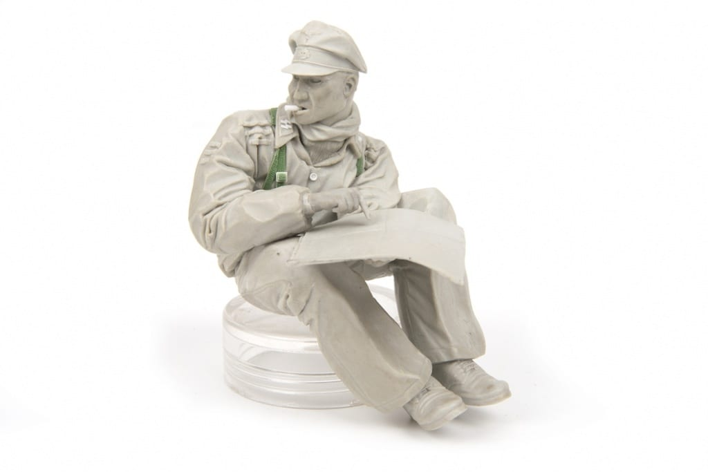 Magic Sculp and Green Stuff are used to create separate parts of this tank crew model
