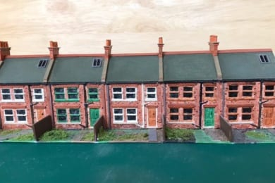 A model rail layout created by taking silicone moulds of customised sets built with plasticard which are then cast in resin